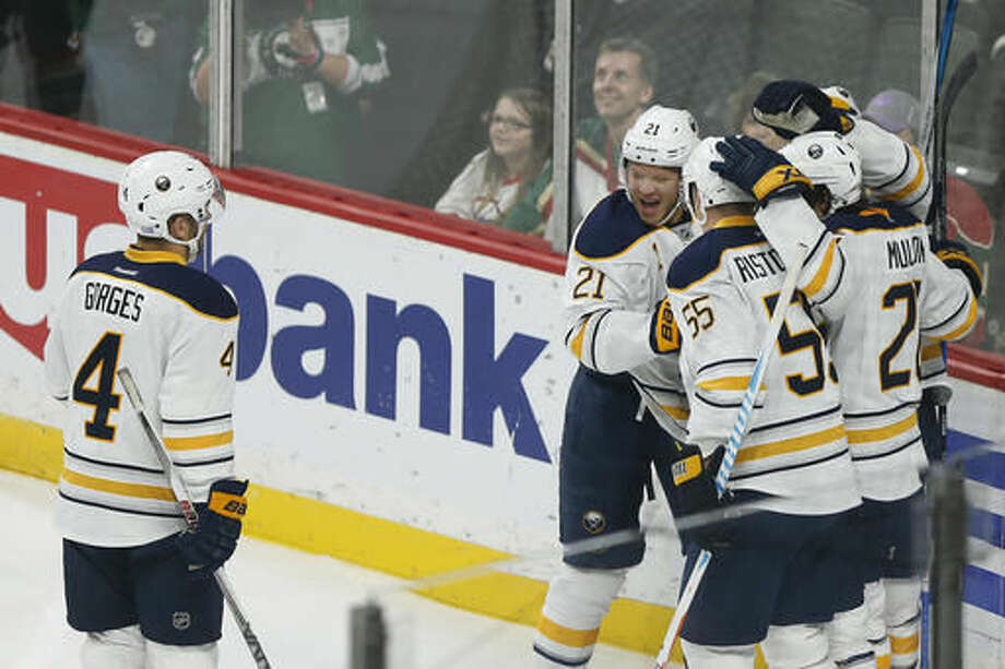 Buffalo Sabres' teammates celebrate after scoring a goal in the first period of an NHL hockey game against the Minnesota Wild, Tuesday, Nov. 1, 2016, in St. Paul, Minn. (AP Photo/Stacy Bengs)