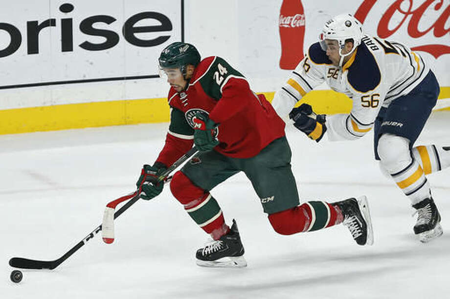 Minnesota Wild's Matt Dumba breaks away from Buffalo Sabres' Justin Bailey in the first period of an NHL hockey game Tuesday, Nov. 1, 2016, in St. Paul, Minn. (AP Photo/Stacy Bengs)