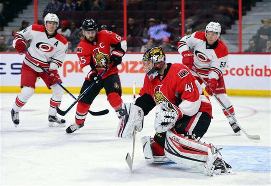 Ottawa Senators' Craig Anderson blocks a shot as he takes on the Carolina Hurricanes during the first period of an NHL hockey game in Ottawa, Tuesday, Nov. 1, 2016. (Sean Kilpatrick/The Canadian Press via AP)