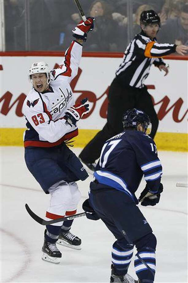 Washington Capitals' Jay Beagle (83) celebrates scoring the game winning goal against the Winnipeg Jets during the third period of an NHL hockey game in Winnipeg, Manitoba, Tuesday, Nov. 1, 2016. The Capitals won 3-2. (John Woods/The Canadian Press via AP)