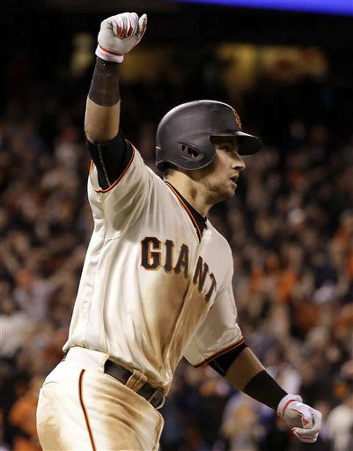 San Francisco Giants' Joe Panik celebrates after hitting a double to score Brandon Crawford against the Chicago Cubs during the thirteenth inning of Game 3 of baseball's National League Division Series in San Francisco, Monday, Oct. 10, 2016. The Giants won 6-5. (AP Photo/Marcio Jose Sanchez)