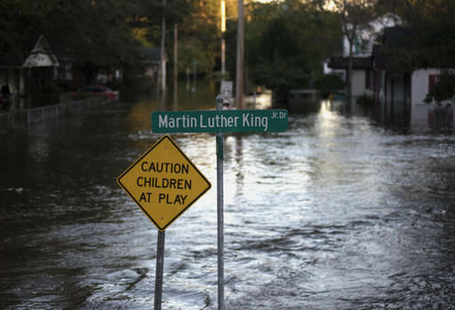Floodwaters caused by rain from Hurricane Matthew cover Martin Luther King Jr. Drive in Lumberton, N.C., Monday, Oct. 10, 2016. (AP Photo/Mike Spencer)