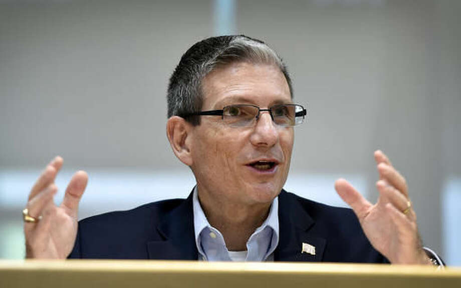 FILE - In this Thursday, June 2, 2016 file photo, U.S. Rep. Joe Heck, R-Nev., speaks during a roundtable event in Henderson, Nev. The contest to replace Nevada Sen. Harry Reid is the tightest Senate race in the country, and it's become a money magnet as allies and enemies seek to flip it. Top Democrats including Hillary Clinton herself and Vice President Joe Biden are stumping for Catherine Cortez Masto this week, while her opponent Heck made headlines as another elected Republican to dump Trump over the weekend. (AP Photo/David Becker, File)