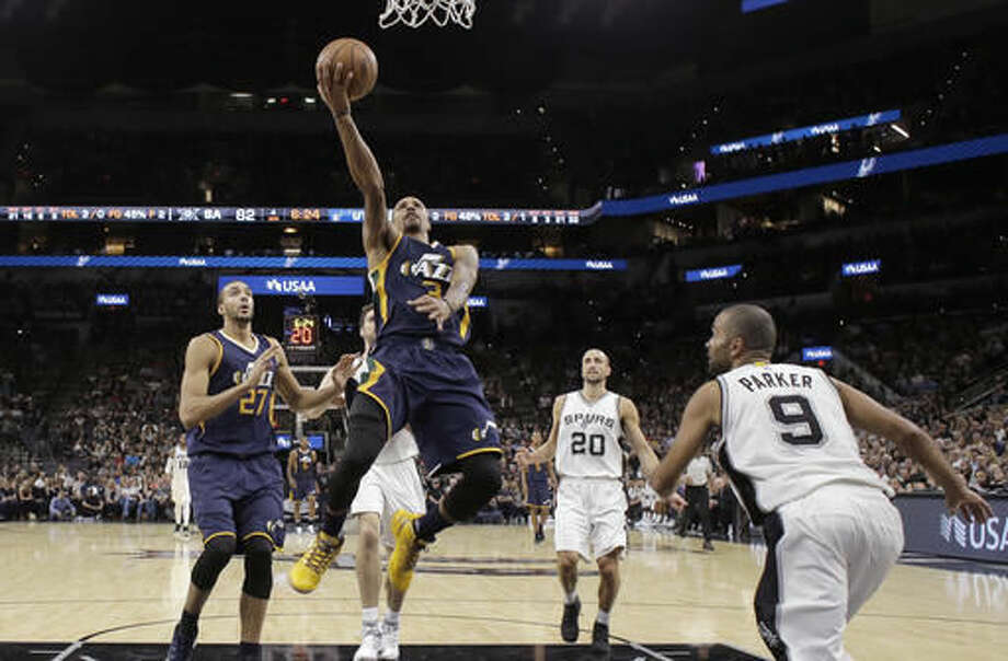 Utah Jazz guard George Hill (3) scores against the San Antonio Spurs during the first half of an NBA basketball game, Tuesday, Nov. 1, 2016, in San Antonio. Utah won 106-91. (AP Photo/Eric Gay)