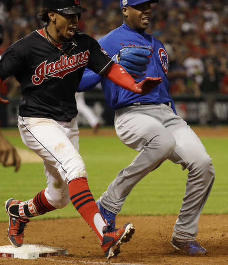 Chicago Cubs relief pitcher Aroldis Chapman reacts after getting Cleveland Indians' Francisco Lindor out at first during the seventh inning of Game 6 of the Major League Baseball World Series Tuesday, Nov. 1, 2016, in Cleveland. (AP Photo/David J. Phillip)