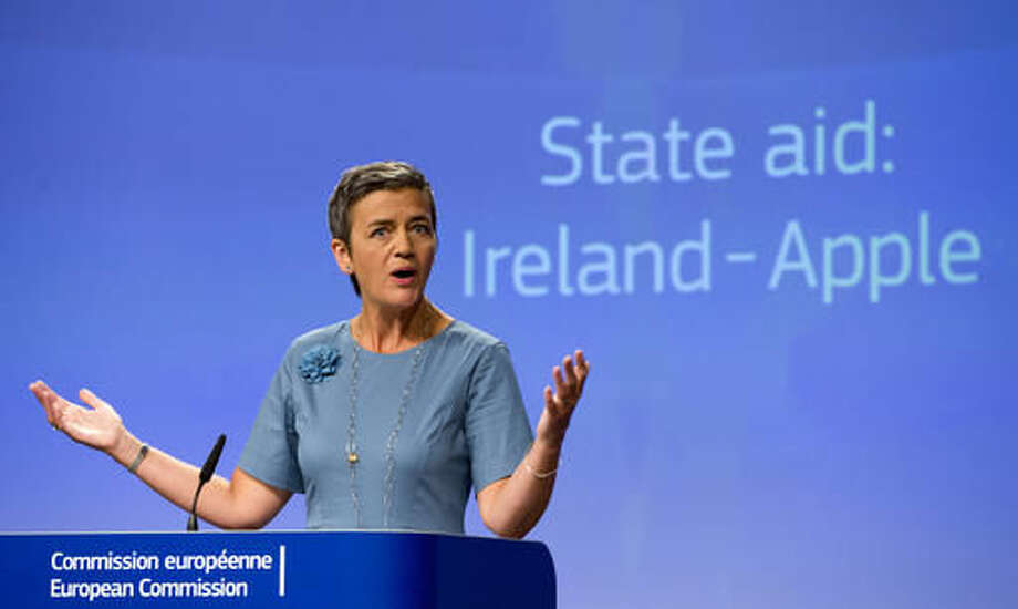 "FILE - A Tuesday, Aug. 30, 2016 photo from files showing European Union Competition Commissioner, Margrethe Vestager, speaking at EU headquarters in Brussels. EU Competition Commissioner Margrethe Vestager, who ruled against Apple, said that ""I am absolutely certain that the decision on Deutsche Bank is built on the facts of the case and American legislation."" (AP Photo/Virginia Mayo, File)"