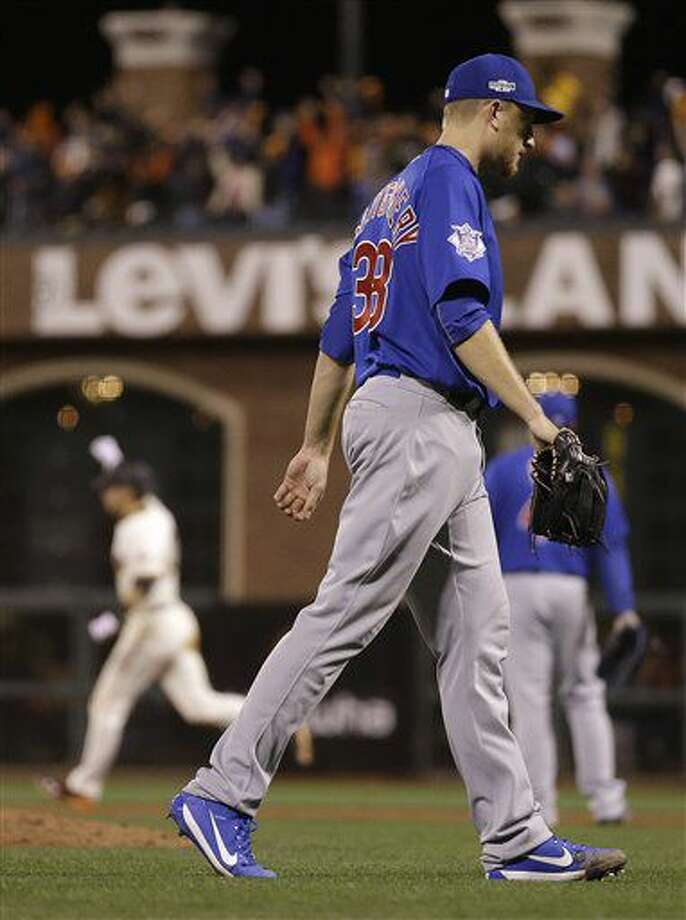 Chicago Cubs pitcher Mike Montgomery (38) walks off the field after allowing a run-scoring double to San Francisco Giants' Joe Panik, rear left, during the thirteenth inning of Game 3 of baseball's National League Division Series in San Francisco, Monday, Oct. 10, 2016. The Giants won 6-5. (AP Photo/Ben Margot)