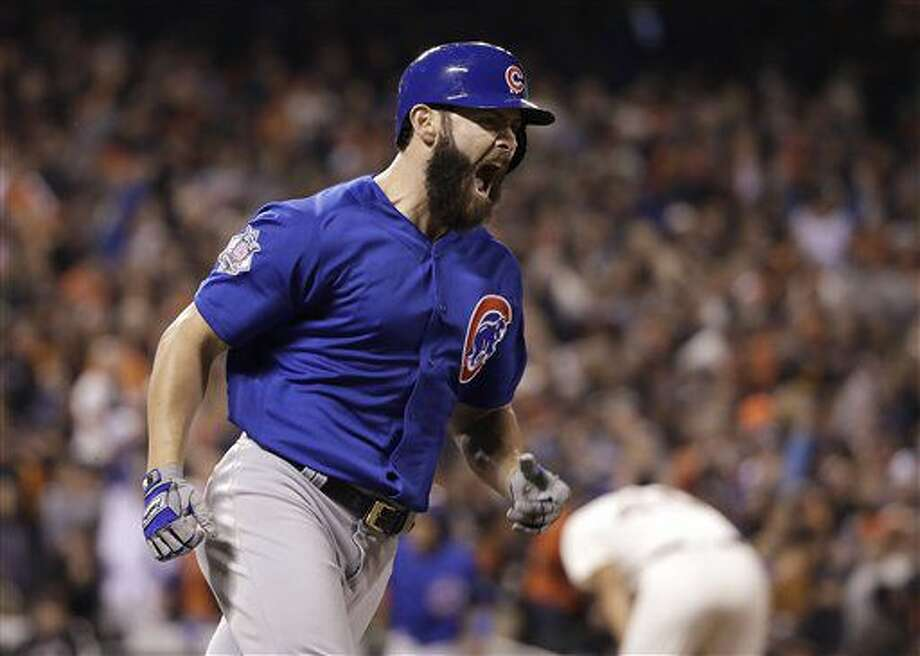 Chicago Cubs' Jake Arrieta reacts after hitting a three-run home run off of San Francisco Giants pitcher Madison Bumgarner during the second inning of Game 3 of baseball's National League Division Series in San Francisco, Monday, Oct. 10, 2016. (AP Photo/Marcio Jose Sanchez)