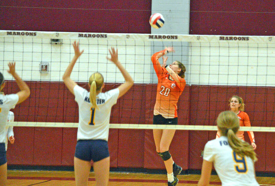 Edwardsville junior Kate Martin goes up for a kill during the first game of Thursday's Class 4A sectional semifinal against O'Fallon at Belleville West.