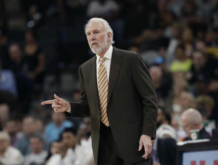 San Antonio Spurs coach Gregg Popovich signals to his players during the first half of an NBA basketball game against the Utah Jazz, Tuesday, Nov. 1, 2016, in San Antonio. Utah won 106-91. (AP Photo/Eric Gay)