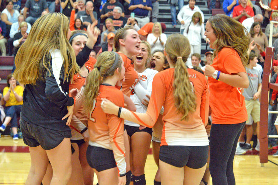 Edwardsville volleyball players celebrate their three-game win over O'Fallon on Tuesday in a Class 4A sectional semifinal at Belleville West.