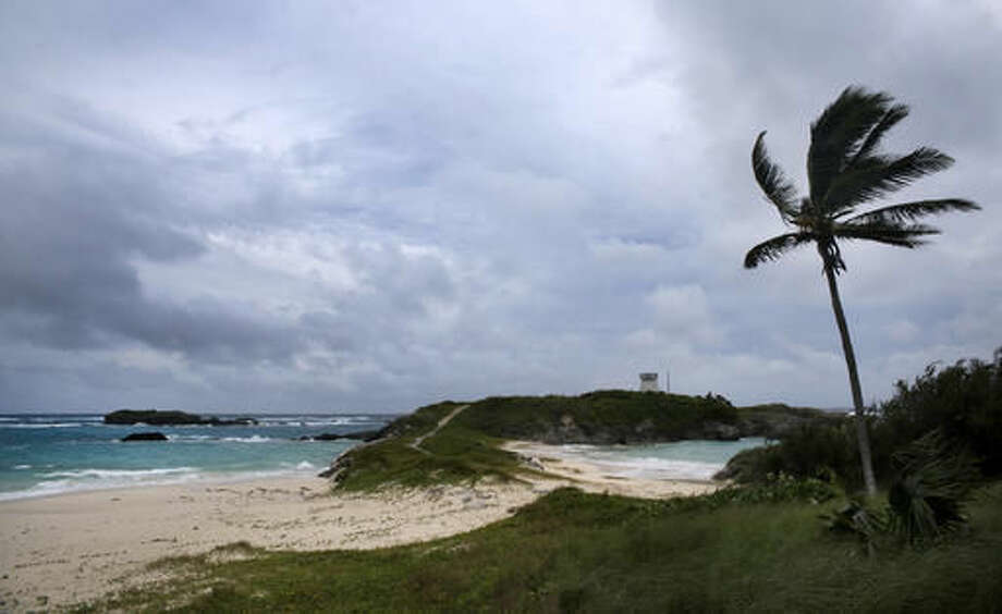 Wind and surf picks up as Hurricane Nicole approaches the Cooper's Island Nature Reserve in St. Georges, Bermuda, Wednesday, Oct. 12, 2016. Wind and rain began battering Bermuda as the British territory braced itself for Hurricane Nicole, which could become a major Category 3 storm before it hits the island on Thursday morning. (AP Photo/Mark Tatem)