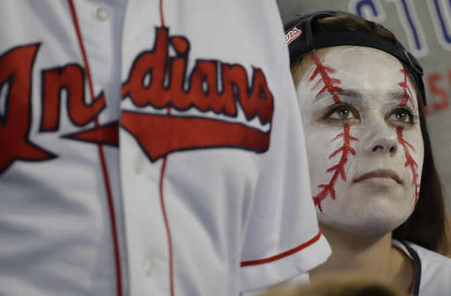 A Cleveland Indians fan reacts during the sixth inning of Game 6 of the Major League Baseball World Series against the Chicago Cubs Tuesday, Nov. 1, 2016, in Cleveland. (AP Photo/David J. Phillip)
