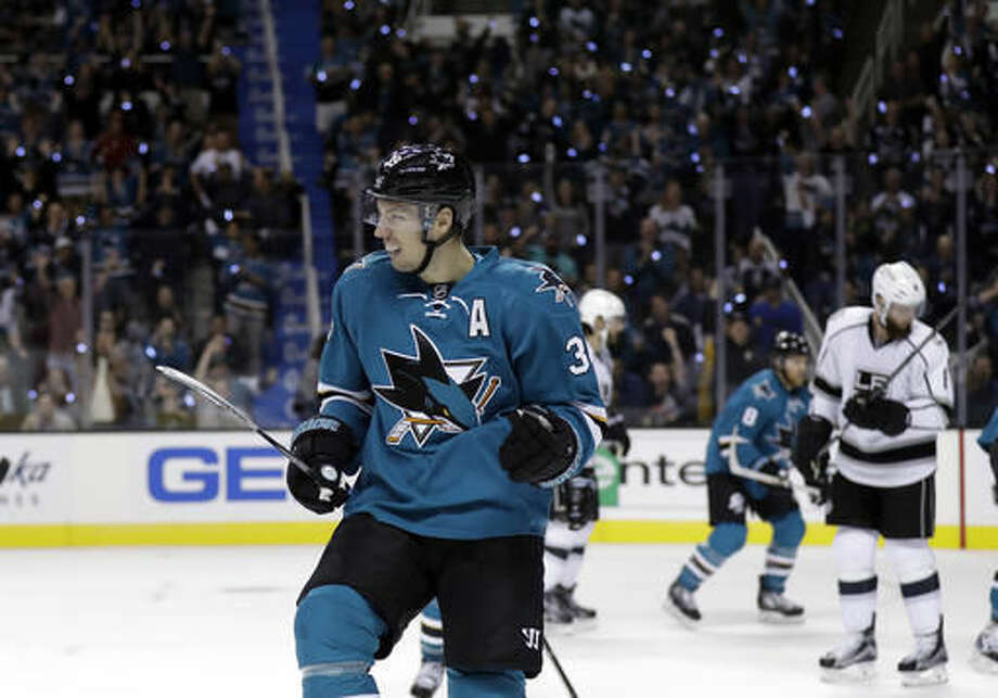 San Jose Sharks' Logan Couture celebrates his goal against against Los Angeles Kings during the first period of an NHL hockey game Wednesday, Oct. 12, 2016, in San Jose, Calif. (AP Photo/Marcio Jose Sanchez)