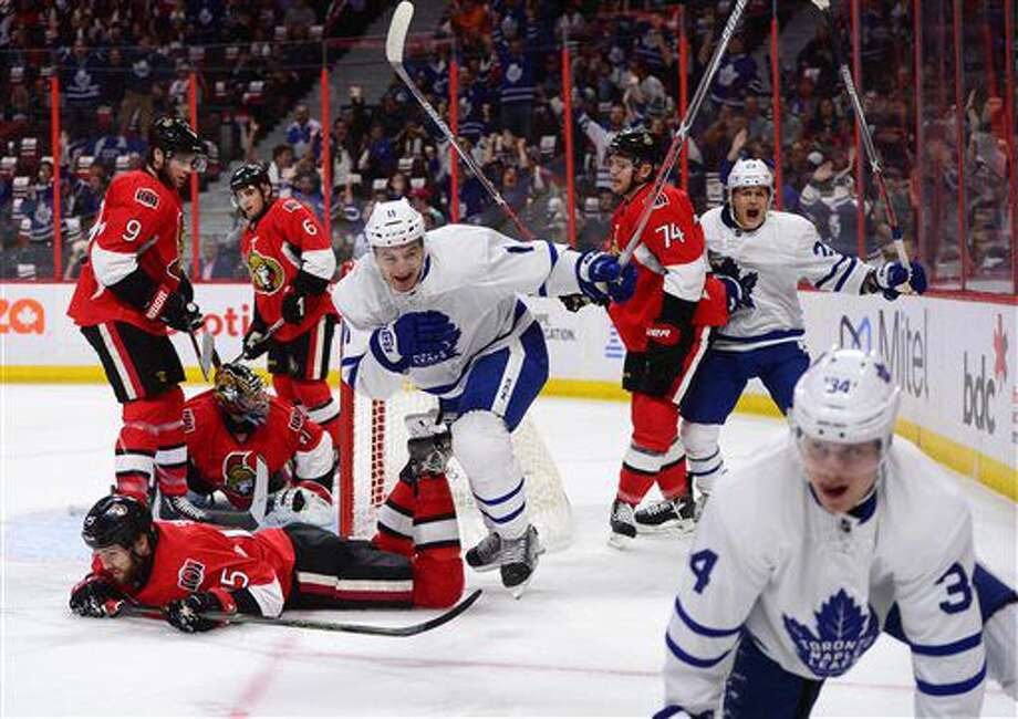 Toronto Maple Leafs celebrate a first-period goal by center Auston Matthews, bottom right, against the Ottawa Senators in an NHL hockey game Wednesday, Oct. 12, 2016, in Ottawa, Ontario. (Sean Kilpatrick/The Canadian Press via AP)