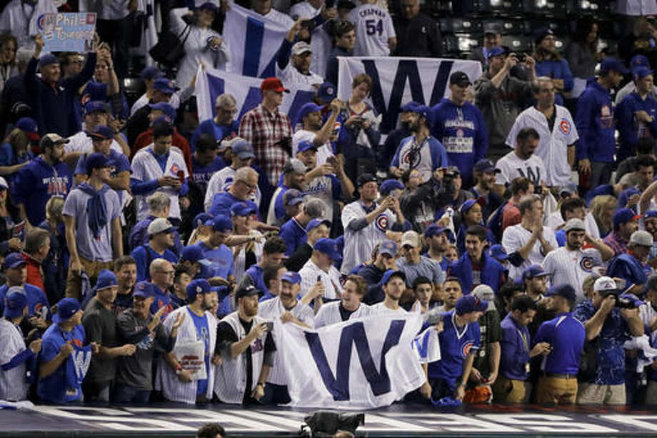 Chicago Cub fans celebrate after their win in Game 6 of the Major League Baseball World Series against the Cleveland Indians Tuesday, Nov. 1, 2016, in Cleveland. The Cubs won 9-3 to tie the series 3-3. (AP Photo/Charlie Riedel)