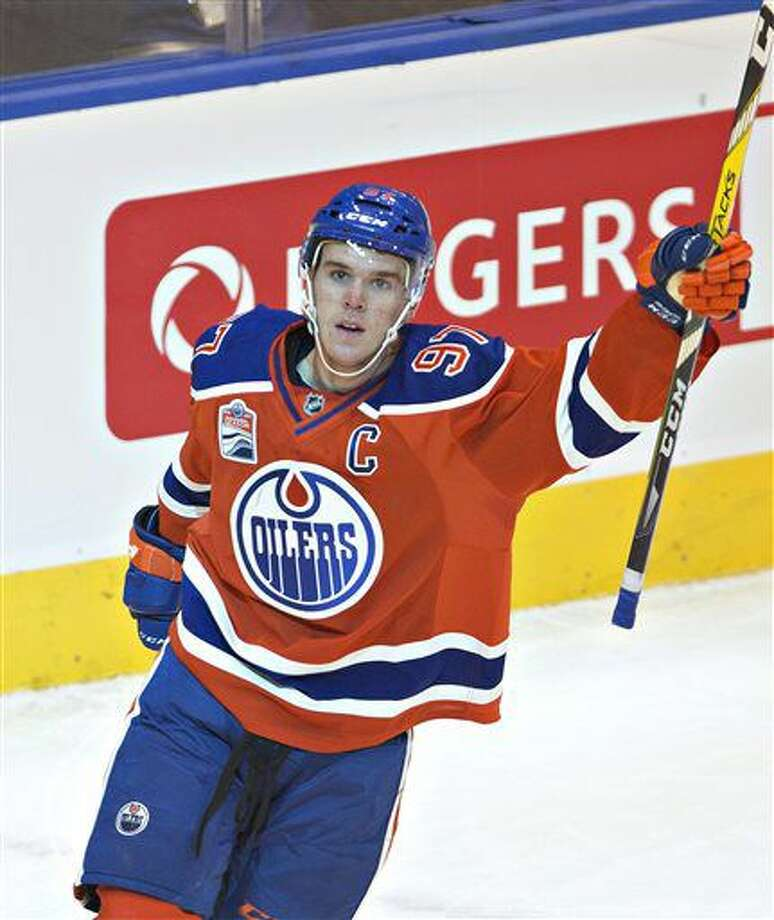 Edmonton Oilers' Connor McDavid celebrates a goal against the Calgary Flames during the second period of an NHL hockey game Wednesday, Oct. 12, 2016, in Edmonton, Alberta. (Jason Franson/The Canadian Press via AP)