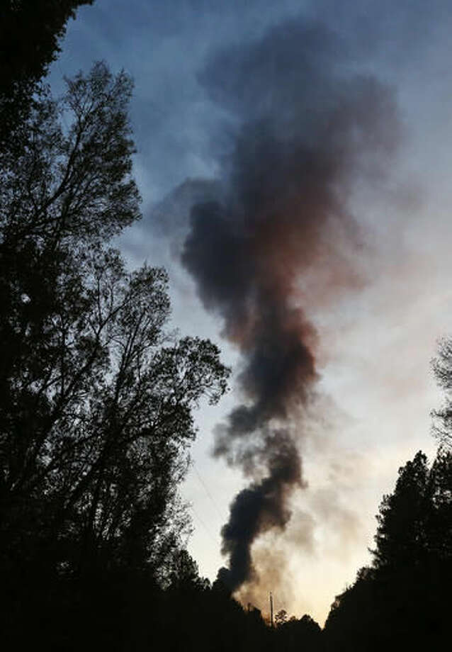 A plume of smoke from a Colonial pipeline explosion fills the sky Monday, Oct. 31, 2016, in Helena, Ala. Colonial Pipeline said in a statement that it has shut down its main pipeline in Alabama after the explosion in a rural part of the state outside Birmingham. (AP Photo/Brynn Anderson)