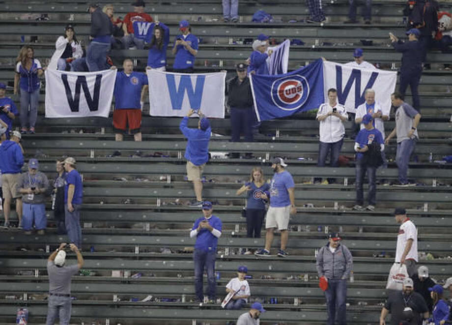 Chicago Cubs fans celebrate at Progressive Field after Game 6 of the Major League Baseball World Series against the Cleveland Indians Tuesday, Nov. 1, 2016, in Cleveland. The Cubs won 9-3 to tie the series 3-3. (AP Photo/David J. Phillip)