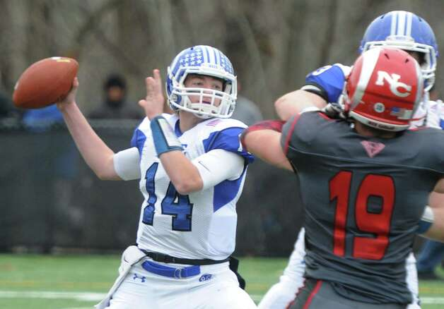 Darien quarterback Brian Peters throws a pass in Darien's 37-34 win over New Canaan in the Turkey Bowl high school football game at Dunning Stadium in New Canaan, Conn. Thursday, Nov. 24, 2016. New Canaan scored 24 unanswered points to tie the game and force an overtime. In overtime, Darien kicked a field goal to take the lead and forced a New Canaan interception to end the game, setting off a wild celebration as fans stormed the field. Photo: Tyler Sizemore / Hearst Connecticut Media / Greenwich Time