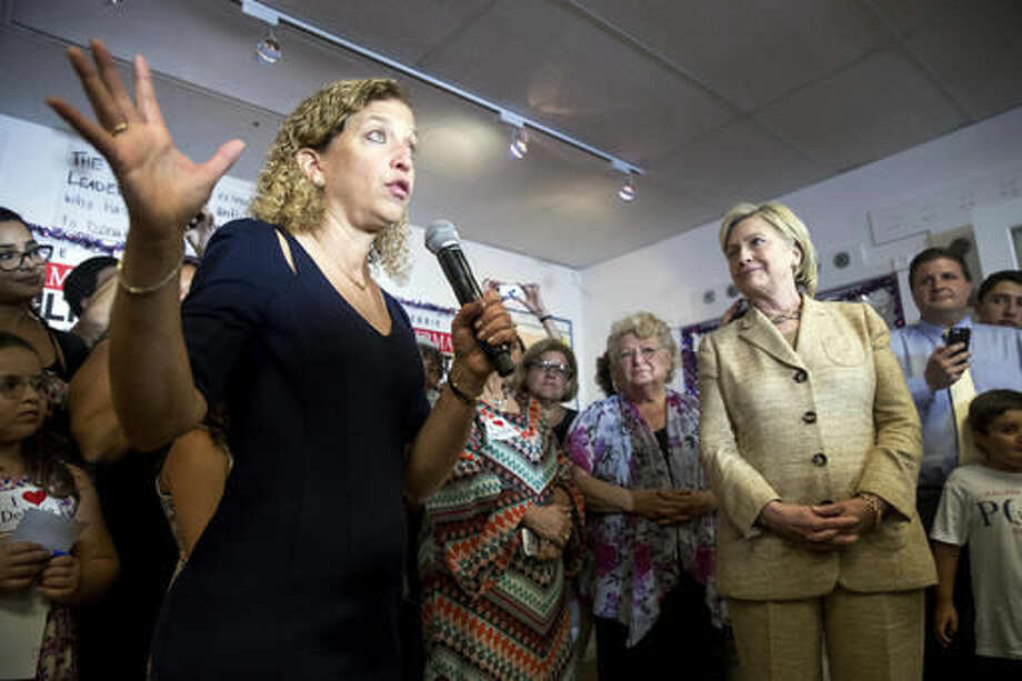 FILE - In this Aug. 9, 2016 file photo, Rep. Debbie Wasserman Schultz, D-Fla. introduces Democratic presidential candidate Hillary Clinton as she stops in to greet workers at a campaign office for Wasserman Schultz, in Davie, Fla. As early as last December, the Clinton campaign was planning to neutralize Democratic National Committee Chairwoman Debbie Wasserman Schultz and forcing her out after the party convention was one of the options under discussion, according to the latest WikiLeaks release of emails hacked from the accounts of Clinton campaign chairman, John Podesta, which were posted Tuesday, Nov. 1, 2016. (AP Photo/Andrew Harnik)