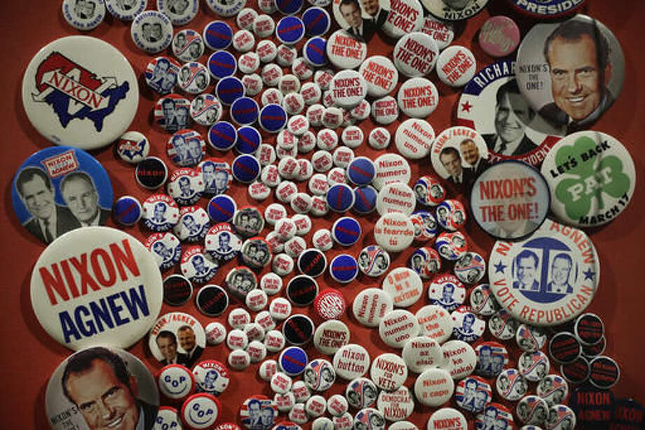 In this Wednesday, Oct. 5, 2016 photo, campaign buttons are on display in the museum at the Richard Nixon Presidential Library and Museum in Yorba Linda, Calif. The museum will reopen Friday, Oct. 14, following a $15 million makeover aimed at bringing the country's 37th president closer to younger generations less familiar with his groundbreaking trip to China or the Watergate scandal. (AP Photo/Jae C. Hong)