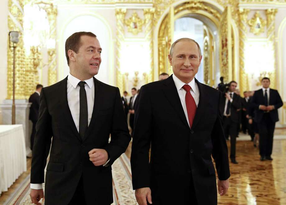 Russian Prime Minister Dmitry Medvedev, left, and President Vladimir Putin walk after the president delivered his annual state of the nation address in the Kremlin in Moscow, Russia, Thursday, Dec. 1, 2016. (Dmitry Astakhov/ Sputnik, Government Press Service Pool photo via AP ) Photo: Dmitry Astakhov, POOL / POOL SPUTNIK GOVERNMENT