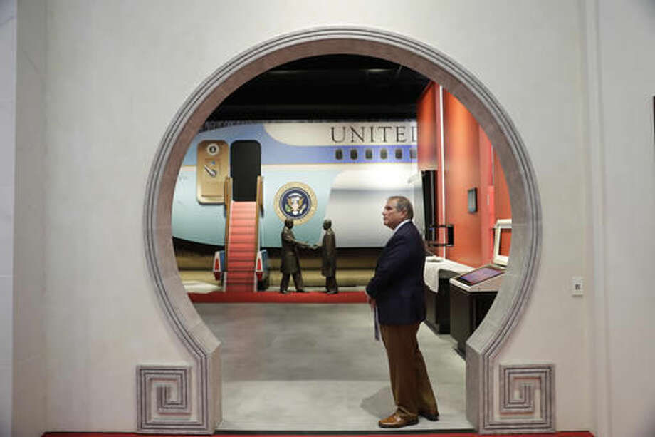 In this Wednesday, Oct. 5, 2016 photo, Michael Ellzey, director of Richard Nixon Presidential Library, stands in the gallery devoted to Nixon's visit to China in the museum in Yorba Linda, Calif. The museum will reopen Friday, Oct. 14, following a $15 million makeover aimed at bringing the country's 37th president closer to younger generations less familiar with his groundbreaking trip to China or the Watergate scandal. (AP Photo/Jae C. Hong)