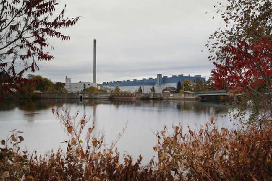 In this Thursday, Oct. 20, 2016 photo the Madison Paper Industries mill sits idle on the Kennebec River after closing down earlier this year in Madison, Maine. Donald Trump's calls to keep jobs on American soil, protect the 2nd Amendment and crack down on the international drug trade have all found favor in the Maine's 2nd Congressional District. (AP Photo/Robert F. Bukaty)