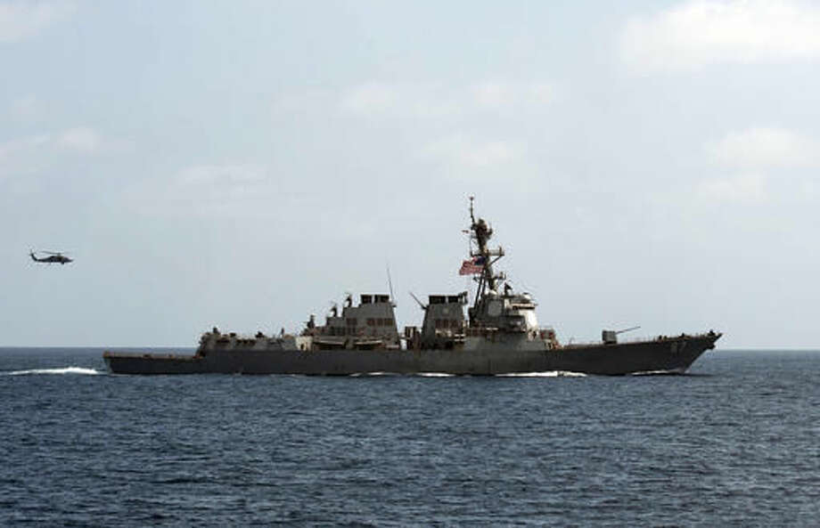 In this image released by the U.S. Navy, the USS Mason (DDG 87), conducts maneuvers as part of a exercise in the Gulf of Oman on Sept. 10, 2016. For the second time this week two missiles were fired at the USS Mason in the Red Sea, and officials believe they were launched by the same Yemen-based Houthi rebels involved in the earlier attack, a U.S. military official said Wednesday. According to the official, the missiles were fired early Oct. 12 at the USS Mason that is conducting routine operations in the region, along with the USS Ponce, an amphibious warship. The official said that neither missile got near the ship. (Mass Communication Specialist 1st Class Blake Midnight/U.S. Navy via AP)