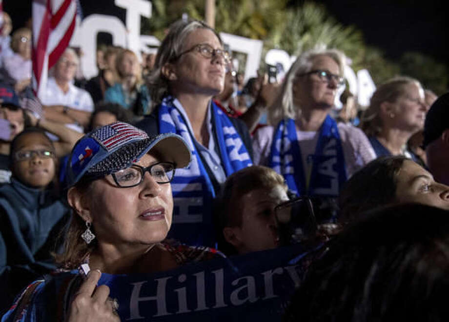 Members of the audience listen as Democratic presidential candidate Hillary Clinton speaks at a rally at Reverend Samuel Delevoe Memorial Park in Fort Lauderdale, Fla., Tuesday, Nov. 1, 2016. (AP Photo/Andrew Harnik)