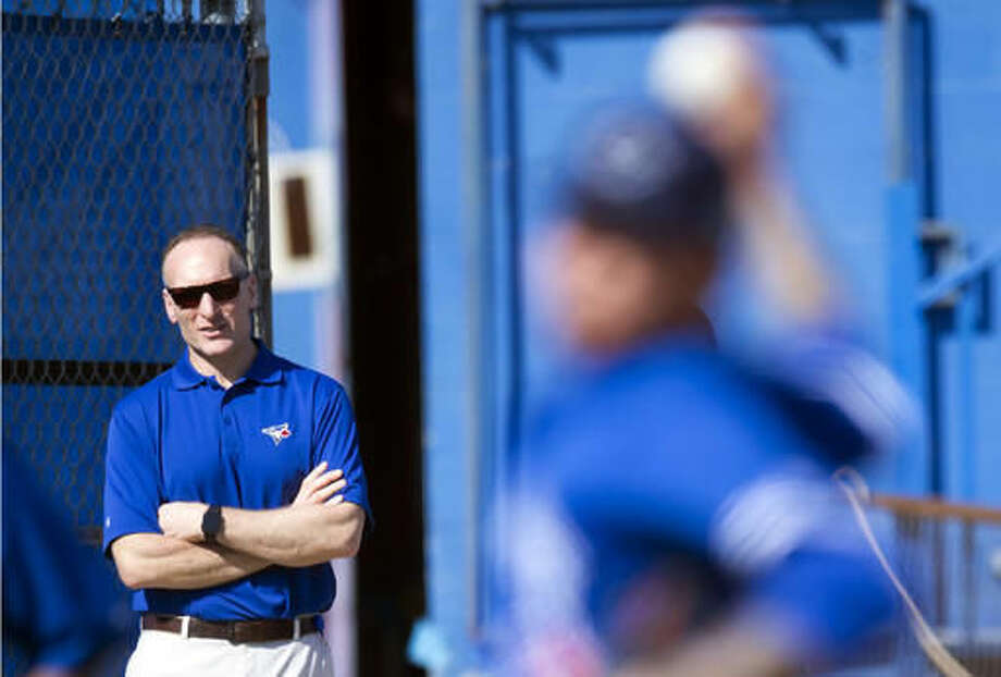 FILE - In this Feb. 22, 2016, file photo, Toronto Blue Jays President and CEO Mark Shapiro watches the first official spring training baseball workout in Dunedin, Fla. Shapiro is the man in the middle of the ALCS. Toronto's president and CEO spent half of his professional baseball life with the Indians before leaving them last year to join the Blue Jays. Now, with both teams meeting with a chance to make the World Series, Shapiro made it clear he'll always have deep fondness for Cleveland, but all that affection will be gone as soon as the first pitch is thrown in Game 1. (Frank Gunn/The Canadian Press via AP, File)