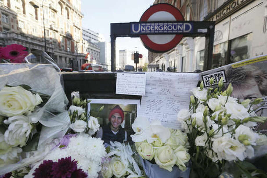 Floral tributes placed at the scene where Italian Prince Filippo Corsini was killed on his bicycle outside Knightsbridge underground station, in London, Wednesday Nov. 2, 2016. Heir to one of Florence's oldest and most illustrious families, Filippo Corsini, 21, was hit by a truck outside luxury department store Harvey Nichols Monday and died of his injuries. (AP Photo/Tim Ireland)