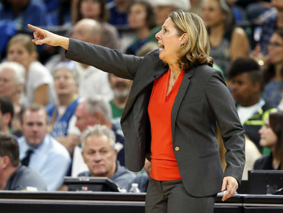 Minnesota Lynx coach Cheryl Reeve motions to her players during the second half in Game 2 of the WNBA basketball finals against the Los Angeles Sparks on Tuesday, Oct. 11, 2016, in Minneapolis. The Lynx won 79-60. (AP Photo/Jim Mone)
