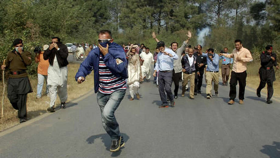 Police fire tear gas to disperse supporters of Pakistani opposition politician Imran Khan, who were trying to reach Khan's house, in Islamabad, Pakistan, Tuesday, Nov. 1, 2016. Khan has called off a mass protest aimed at shutting down the capital and forcing the resignation of the prime minister. (AP Photo/B.K. Bangash)