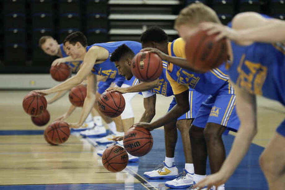 UCLA players run a drill during the NCAA college basketball team's media availability, Wednesday, Oct. 12, 2016, in Los Angeles. (AP Photo/Jae C. Hong)