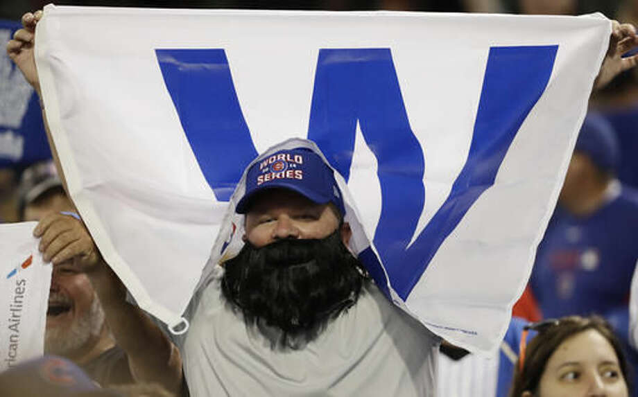 A Chicago Cubs fan cheers at Progressive Field after Game 6 of the Major League Baseball World Series against the Cleveland Indians Tuesday, Nov. 1, 2016, in Cleveland. The Cubs won 9-3 to tie the series 3-3. (AP Photo/David J. Phillip)
