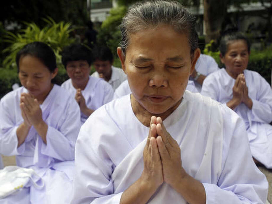 Thais pray for Thailand's King Bhumibol Adulyadej at Siriraj Hospital where the king is being treated in Bangkok, Thailand, Thursday, Oct. 13, 2016. The royal palace said in a statement late Wednesday that the 88-year-old king's blood pressure had dropped, his liver and kidneys were not working properly and he remained on a ventilator. (AP Photo/Sakchai Lalit)