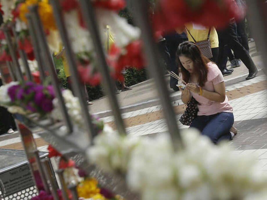 Thais pray for Thai King Bhumibol Adulyadej at Siriraj Hospital where the king is being treated in Bangkok, Thailand, Thursday, Oct. 13, 2016. The royal palace said in a statement late Wednesday that the 88-year-old king's blood pressure had dropped, his liver and kidneys were not working properly and he remained on a ventilator. (AP Photo/Sakchai Lalit)