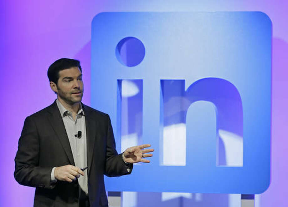 FILE - In this Sept. 22, 2016 file photo, LinkedIn CEO Jeff Weiner speaks during a product announcement at his company's headquarters in San Francisco. LinkedIn, which calls itself the social network for professionals, is adding a service that provides members with pay information for a variety of jobs, including a break-down by such factors as location, industry, education and experience. It's based on anonymized data submitted by LinkedIn members, including details about base pay and other compensation, such as bonuses and stock grants. (AP Photo/Eric Risberg)