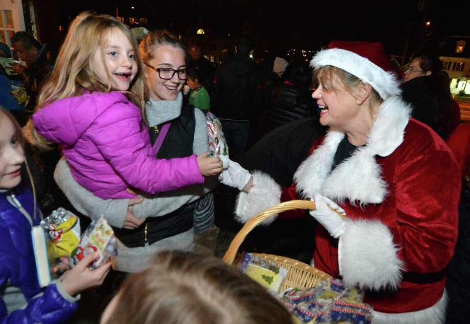 Mrs. Clause passes out candy canes to 6yr old Lianne Duncan and Wiktoria Piktel during the city of Norwalk's tree lighting celebration at City Hall on Thursday December 1, 2016 in Norwalk Conn. Photo: Alex Von Kleydorff / Hearst Connecticut Media / Connecticut Post
