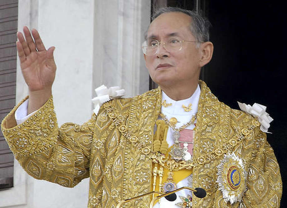 FILE - In this June 9, 2006, file photo released by the Thai Government Public Relations Department, Thailand King Bhumibol Adulyadej acknowledges the crowd in Bangkok during the celebrations of the 60th anniversary of his accession to the throne. Thailand's Royal Palace said on Thursday, Oct. 13, 2016, that Thailand's King Bhumibol, the world's longest-reigning monarch, has died at age 88. (Thai Government Public Relations Department via AP, File)