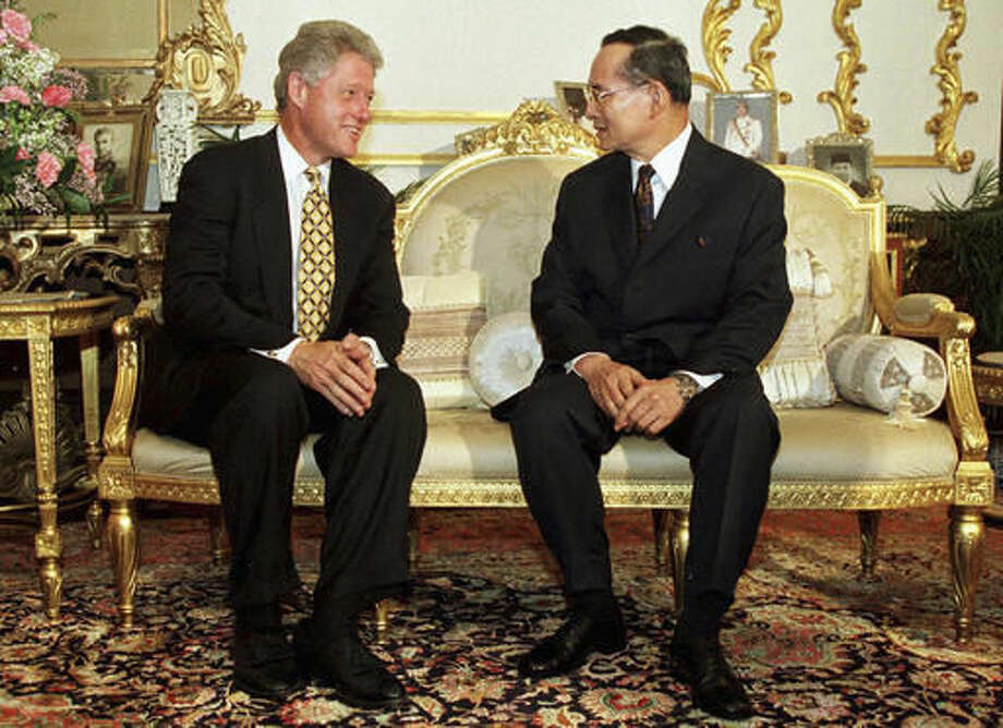 FILE - In this Nov. 25, 1996, file photo, U.S. President Bill Clinton, left, meets with Thailand's King Bhumibol Adulyadej at Chitrlada Palace in Bangkok. Thailand's Royal Palace said on Thursday, Oct. 13, 2016, that King Bhumibol, the world's longest-reigning monarch, has died at age 88. (Pool Photo via AP, File)