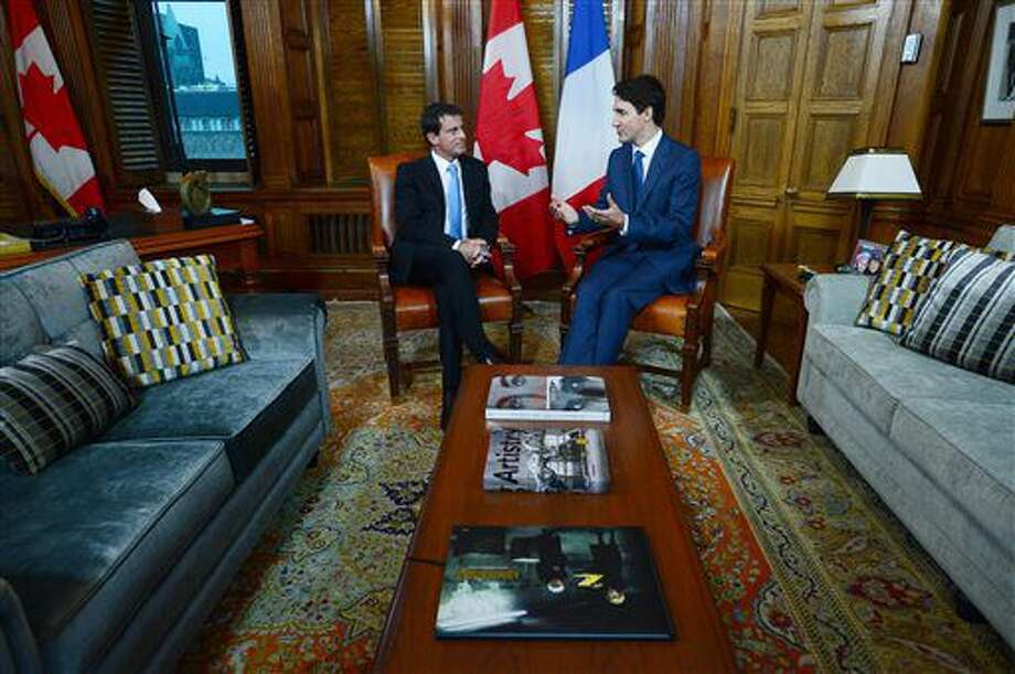 Prime Minister Justin Trudeau and Prime Minister of the France Manuel Valls have a meeting on Parliament Hill in Ottawa, Thursday Oct. 13, 2016. (Adrian Wyld/The Canadian Press via AP)