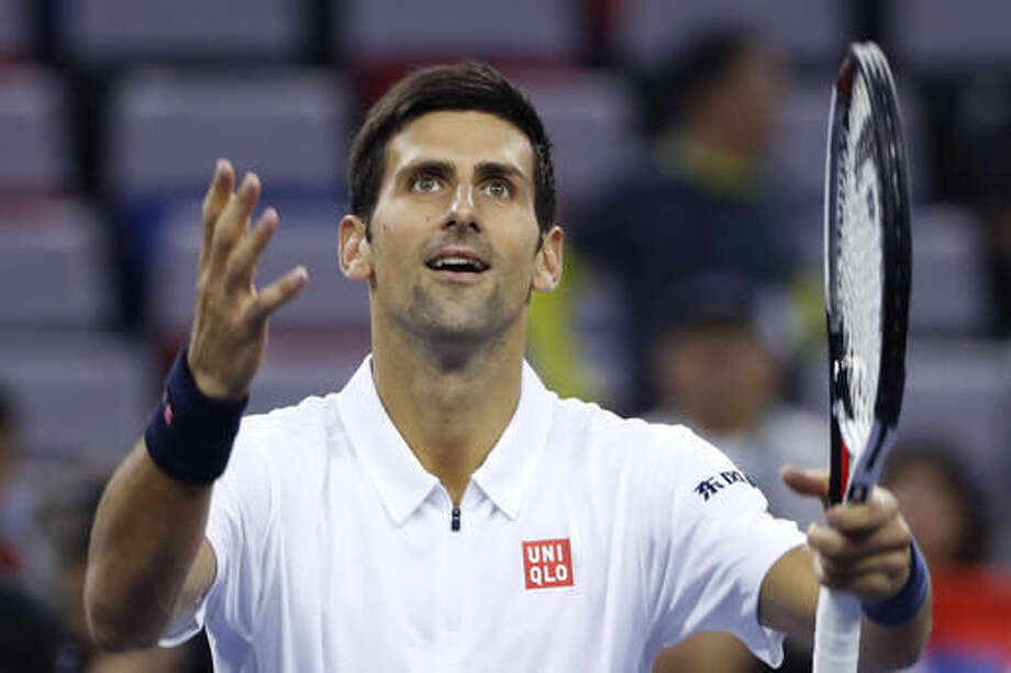 Novak Djokovic of Serbia celebrates after defeating Vasek Pospisil of Canada in the men's singles match of the Shanghai Masters tennis tournament at Qizhong Forest Sports City Tennis Center in Shanghai, China, Thursday, Oct. 13, 2016. (AP Photo/Andy Wong)