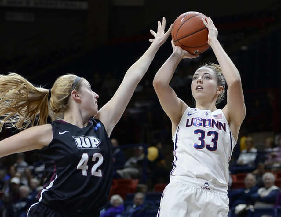 In this Tuesday, Nov. 1, 2016 photo Connecticut's Katie Lou Samuelson shoots over Indiana University of Pennsylvania's Megan Smith, left, during an NCAA college basketball exhibition game in Storrs, Conn. UConn enters the season on a 75-game winning streak, but is ranked third behind Notre Dame and Baylor in first AP poll. (AP Photo/Jessica Hill)