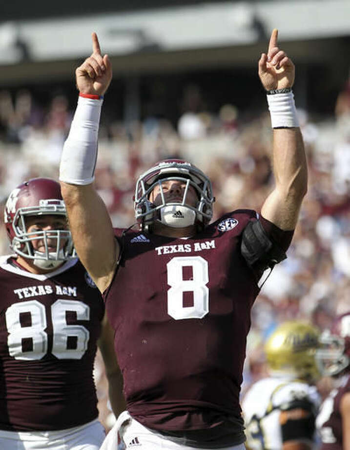 FILE - In this Sept. 3, 2016, file photo, Texas A&M quarterback Trevor Knight (8) reacts after scoring a touchdown during the third quarter of an NCAA college football game against UCLA in College Station, Texas. Texas A&M was ranked fourth behind Alabama, Clemson and Michigan in the season's first College Football Playoff rankings, announced Tuesday, Nov. 1, 2016. (AP Photo/Sam Craft, File)
