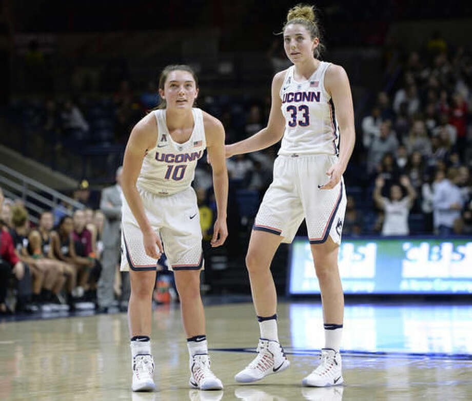 In this Tuesday, Nov. 1, 2016 photo Connecticut's Molly Bent, left, and Katie Lou Samuelson, right, stand together in during an NCAA college basketball exhibition game against Indiana University of Pennsylvania in Storrs, Conn. UConn enters the season on a 75-game winning streak, but is ranked third behind Notre Dame and Baylor in first AP poll. (AP Photo/Jessica Hill)