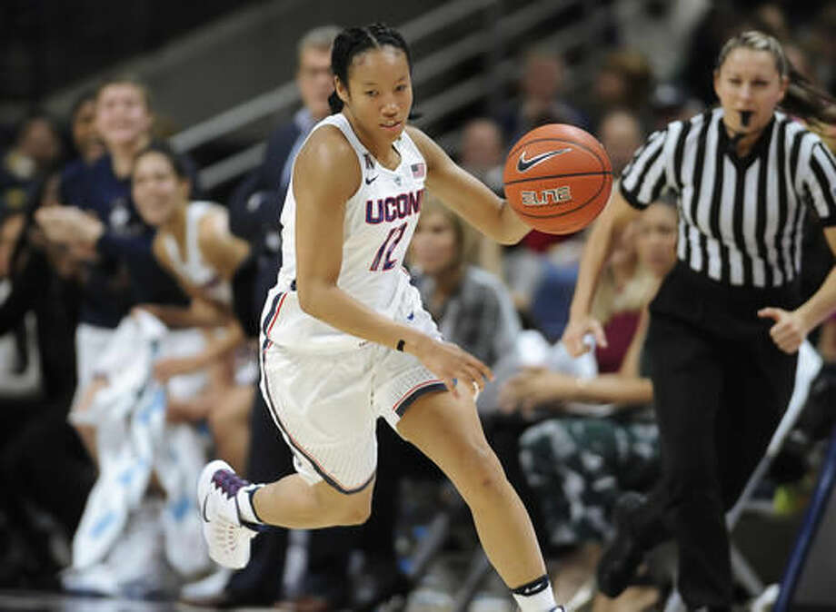 In this Tuesday, Nov. 1, 2016 photo Connecticut's Saniya Chong runs up court during an NCAA college basketball exhibition game against Indiana University of Pennsylvania in Storrs, Conn. UConn enters the season on a 75-game winning streak, but is ranked third behind Notre Dame and Baylor in first AP poll. (AP Photo/Jessica Hill)