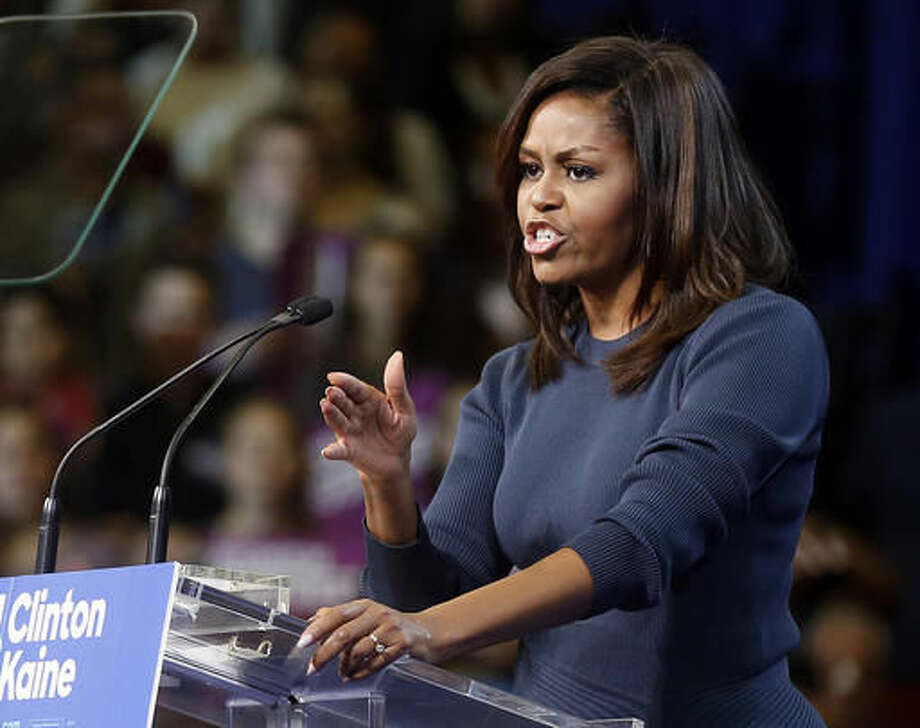 First lady Michelle Obama speaks during a campaign rally for Democratic presidential candidate Hillary Clinton Thursday, Oct. 13, 2016, in Manchester, N.H. (AP Photo/Jim Cole)